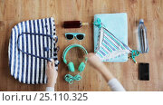 Купить «hands packing beach accessories to bag», видеоролик № 25110325, снято 13 января 2017 г. (c) Syda Productions / Фотобанк Лори