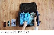 Купить «hands packing travel bag with personal stuff», видеоролик № 25111377, снято 13 января 2017 г. (c) Syda Productions / Фотобанк Лори