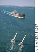 Купить «Two yachts sailing close hauled into the path of an oncoming rusty tanker.», фото № 25111597, снято 25 июня 2019 г. (c) Nature Picture Library / Фотобанк Лори