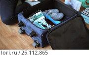 Купить «hands packing travel bag with personal stuff», видеоролик № 25112865, снято 13 января 2017 г. (c) Syda Productions / Фотобанк Лори