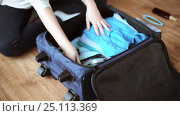 Купить «hands packing travel bag with personal stuff», видеоролик № 25113369, снято 13 января 2017 г. (c) Syda Productions / Фотобанк Лори