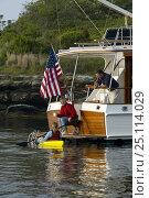 Купить «Kayaking from a Grand Banks motoryacht.», фото № 25114029, снято 16 октября 2019 г. (c) Nature Picture Library / Фотобанк Лори