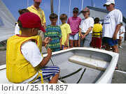 Купить «Children learing how to tie a figure of eight knot at a sailing school in Newport, Rhode Island, USA.», фото № 25114857, снято 25 июня 2019 г. (c) Nature Picture Library / Фотобанк Лори