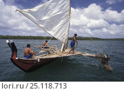 Men sailing a popow, the traditional outrigger canoe used on Yap, Micronesia. ^^^The popow is characterized by v shaped ends, used for travel and fishing... Стоковое фото, фотограф Roberto Rinaldi / Nature Picture Library / Фотобанк Лори