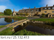 Купить «Cotswolds village of Lower Slaughter with stone clapper bridge, Gloucestershire, UK. October 2015.», фото № 25132413, снято 17 декабря 2017 г. (c) Nature Picture Library / Фотобанк Лори