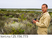 Купить «Man birdwatching  in Rocherpan National Park, Western Cape, South Africa.», фото № 25156773, снято 16 июля 2019 г. (c) Nature Picture Library / Фотобанк Лори