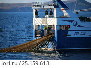 Купить «Fishing vessel 'Ocean Harvest' working in calm conditions with Fair Isle in the distance. North Sea, UK, August 2014. Property released.  All non-editorial uses must be cleared individually.», фото № 25159613, снято 16 октября 2018 г. (c) Nature Picture Library / Фотобанк Лори