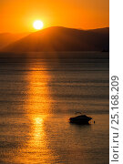 Купить «Sunset reflected on the surface of the Aegean Sea on a calm day with a speedboat, Evia Island, Greece. July 2014.», фото № 25168209, снято 15 августа 2018 г. (c) Nature Picture Library / Фотобанк Лори