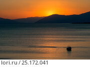 Купить «Sunset reflected on the surface of the Aegean Sea on a calm day with a speedboat, Evia Island, Greece. July 2014.», фото № 25172041, снято 15 августа 2018 г. (c) Nature Picture Library / Фотобанк Лори