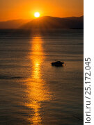 Купить «Sunset reflected on the surface of the Aegean Sea on a calm day with a speedboat, Evia Island, Greece. July 2014.», фото № 25172045, снято 15 августа 2018 г. (c) Nature Picture Library / Фотобанк Лори