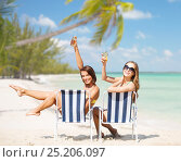 Купить «happy young women with drinks sunbathing on beach», фото № 25206097, снято 11 июля 2013 г. (c) Syda Productions / Фотобанк Лори
