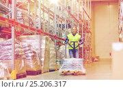 Купить «man carrying loader with goods at warehouse», фото № 25206317, снято 9 декабря 2015 г. (c) Syda Productions / Фотобанк Лори