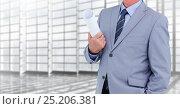 Купить «Architect Torso holding plans in a corridor against windows», фото № 25206381, снято 18 января 2019 г. (c) Wavebreak Media / Фотобанк Лори