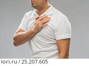 Купить «close up of man with heart ache or chest pain», фото № 25207605, снято 21 декабря 2016 г. (c) Syda Productions / Фотобанк Лори