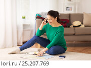 woman with travel map calling on smartphone. Стоковое фото, фотограф Syda Productions / Фотобанк Лори