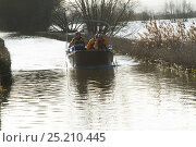Купить «Rescue boat carrying flood victims to Muchelney during January 2014 floods, Somerset Levels, England, UK, 11th January 2014.», фото № 25210445, снято 15 августа 2018 г. (c) Nature Picture Library / Фотобанк Лори