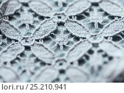 Купить «close up of lace textile or fabric background», фото № 25210941, снято 15 сентября 2016 г. (c) Syda Productions / Фотобанк Лори