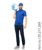 Купить «happy delivery man with bottle of water», фото № 25211269, снято 3 декабря 2016 г. (c) Syda Productions / Фотобанк Лори