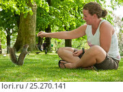 Купить «Woman feeding a Grey squirrel (Sciurus carolinensis) in Regent's Park, London, England, UK, April 2011 Model Release Available», фото № 25270141, снято 29 февраля 2020 г. (c) Nature Picture Library / Фотобанк Лори