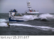 Купить «Pleasure craft alongside trawler on a choppy North Sea, Europe, February 2011. Property released.», фото № 25311617, снято 18 декабря 2018 г. (c) Nature Picture Library / Фотобанк Лори