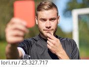 Купить «referee on football field showing red card», фото № 25327717, снято 18 сентября 2016 г. (c) Syda Productions / Фотобанк Лори