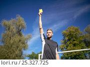 Купить «referee on football field showing yellow card», фото № 25327725, снято 18 сентября 2016 г. (c) Syda Productions / Фотобанк Лори