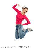 Купить «smiling young woman jumping in air», фото № 25328097, снято 22 декабря 2016 г. (c) Syda Productions / Фотобанк Лори