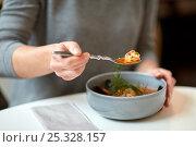 Купить «woman eating fish soup at cafe or restaurant», фото № 25328157, снято 16 января 2017 г. (c) Syda Productions / Фотобанк Лори