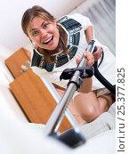 Купить «Happy adult girl vacuuming floor», фото № 25377825, снято 17 августа 2018 г. (c) Яков Филимонов / Фотобанк Лори