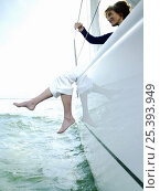 Купить «Woman dangling her legs over the side of 40ft yacht sailing on the IJmeer near Amsterdam, Holland. September 2008.», фото № 25393949, снято 20 августа 2018 г. (c) Nature Picture Library / Фотобанк Лори