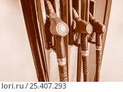 Купить «Пистолеты для заправки топлива на бензоколонке», фото № 25407293, снято 12 февраля 2017 г. (c) Сергеев Валерий / Фотобанк Лори