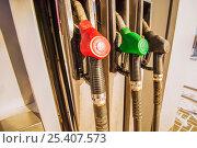 Купить «Пистолеты для заправки топлива на бензоколонке», фото № 25407573, снято 12 февраля 2017 г. (c) Сергеев Валерий / Фотобанк Лори
