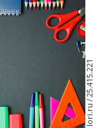 School and office supplies on dark background. Top view with copy space. Стоковое фото, фотограф Иван Карпов / Фотобанк Лори