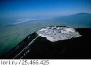 Купить «Aerial view of Ol Doinyo Lengai Crater (The Mountain of God) Rift Valley, Tanzania. Note- small cones on crater floor formed by previous eruptions of lava, still active.», фото № 25466425, снято 24 мая 2018 г. (c) Nature Picture Library / Фотобанк Лори