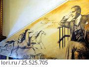 Портрет Михаила Булгакова на стене в музее Булгаковского дома на Большой Садовой улице,10 в Москве (2015 год). Редакционное фото, фотограф stargal / Фотобанк Лори