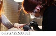 Купить «Professional nails care in process, cosmetician with mask in black gloves making nails female customer for a manicure with gel cover», видеоролик № 25533353, снято 5 апреля 2020 г. (c) Константин Шишкин / Фотобанк Лори