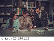 Купить «Confident team of engineers working together in a architect studio.», фото № 25534233, снято 18 марта 2016 г. (c) Andrejs Pidjass / Фотобанк Лори