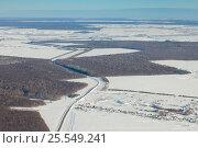 Купить «Aerial view over snowy field and road», фото № 25549241, снято 4 февраля 2017 г. (c) Владимир Мельников / Фотобанк Лори