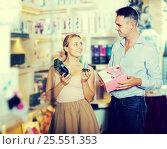 Купить «Couple choosing sex toy in sex shop», фото № 25551353, снято 23 марта 2019 г. (c) Яков Филимонов / Фотобанк Лори