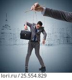 Купить «Businessman puppet being manipulated by boss», фото № 25554829, снято 20 мая 2019 г. (c) Elnur / Фотобанк Лори