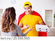 Купить «Superhero pizza delivery guy with red cover», фото № 25555593, снято 23 декабря 2016 г. (c) Elnur / Фотобанк Лори