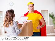 Купить «Superhero delivery guy with box», фото № 25555601, снято 23 декабря 2016 г. (c) Elnur / Фотобанк Лори