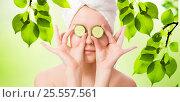 Купить «Woman with cucumbers on eyes on natural blurred background», фото № 25557561, снято 20 мая 2013 г. (c) Валерия Потапова / Фотобанк Лори