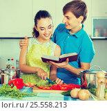 Купить «Young husband helping wife», фото № 25558213, снято 20 ноября 2019 г. (c) Яков Филимонов / Фотобанк Лори