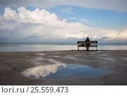 Купить «Lonely woman sitting on the beach», фото № 25559473, снято 3 июня 2016 г. (c) Анна Костенко / Фотобанк Лори