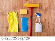 Купить «swab with cleaning stuff on wooden background», фото № 25572129, снято 27 октября 2016 г. (c) Syda Productions / Фотобанк Лори