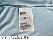 Купить «label with users manual of clothing item», фото № 25572389, снято 15 сентября 2016 г. (c) Syda Productions / Фотобанк Лори