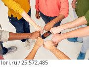 Купить «hands of international people making fist bump», фото № 25572485, снято 29 октября 2016 г. (c) Syda Productions / Фотобанк Лори
