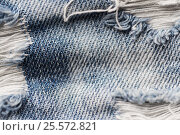 Купить «close up of holes on shabby denim or jeans clothes», фото № 25572821, снято 15 сентября 2016 г. (c) Syda Productions / Фотобанк Лори