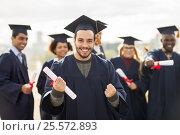 Купить «happy student with diploma celebrating graduation», фото № 25572893, снято 24 сентября 2016 г. (c) Syda Productions / Фотобанк Лори
